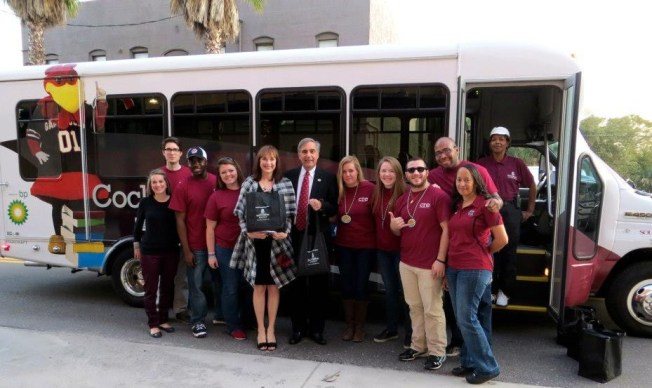 USC President Harris Pastides and his wife, Patricia Moore-Pastides, are shown with student volunteers for the Cocky's Reading Express program in South Carolina.